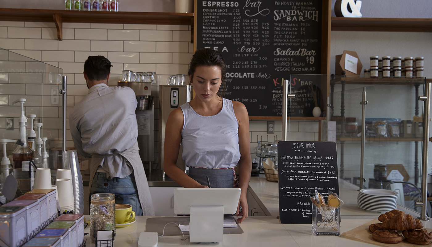 Lady serving a cafe counter