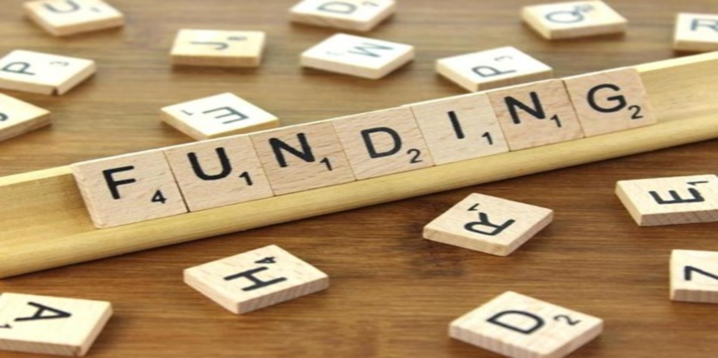 Scrabble letters spelling funding