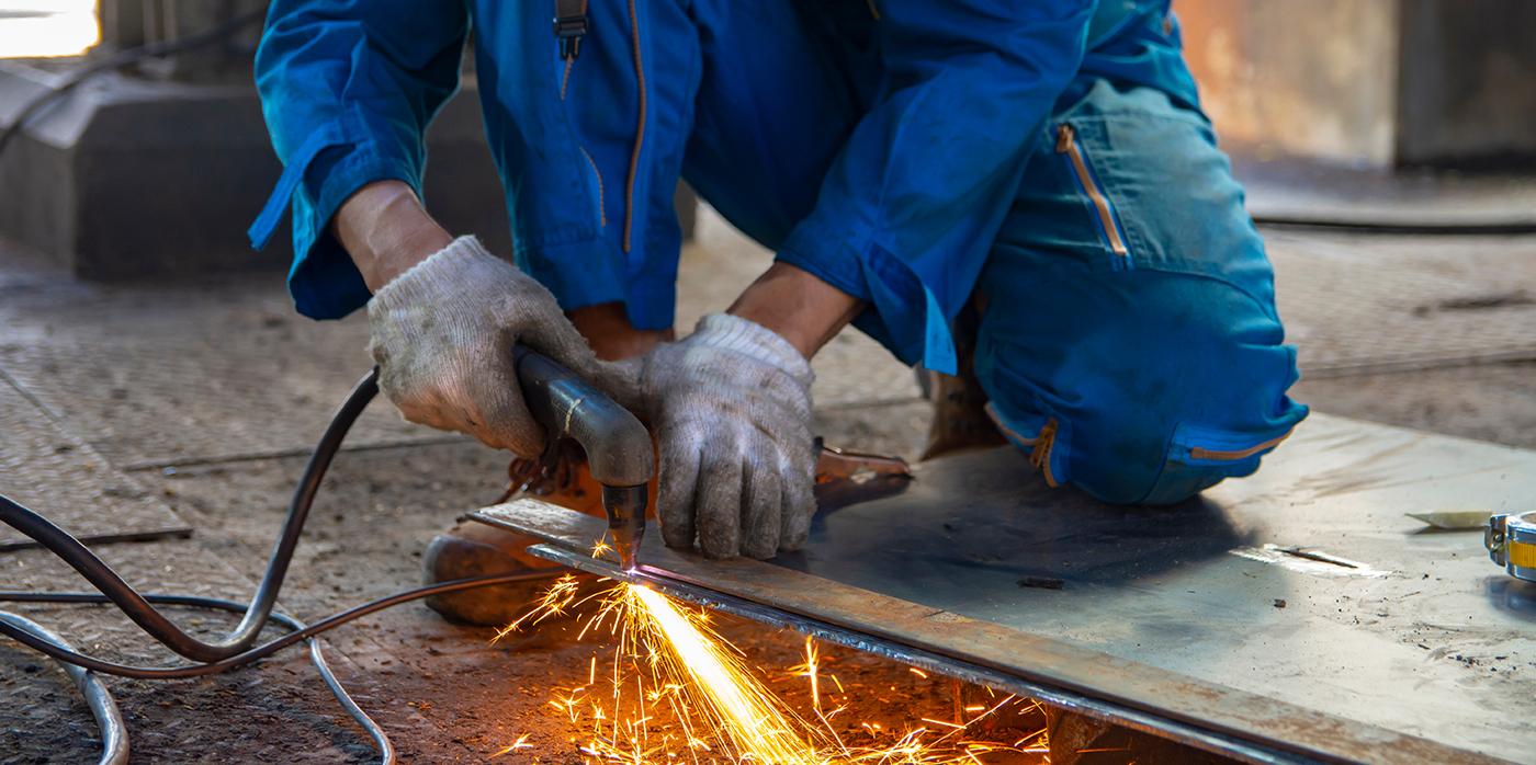 Image of someone welding