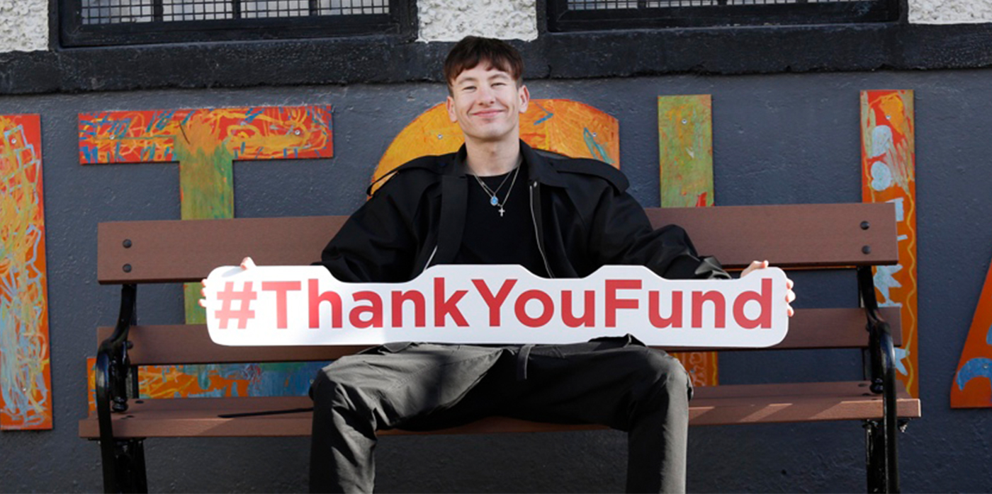 Thank you fund sign across image of person sitting in chair