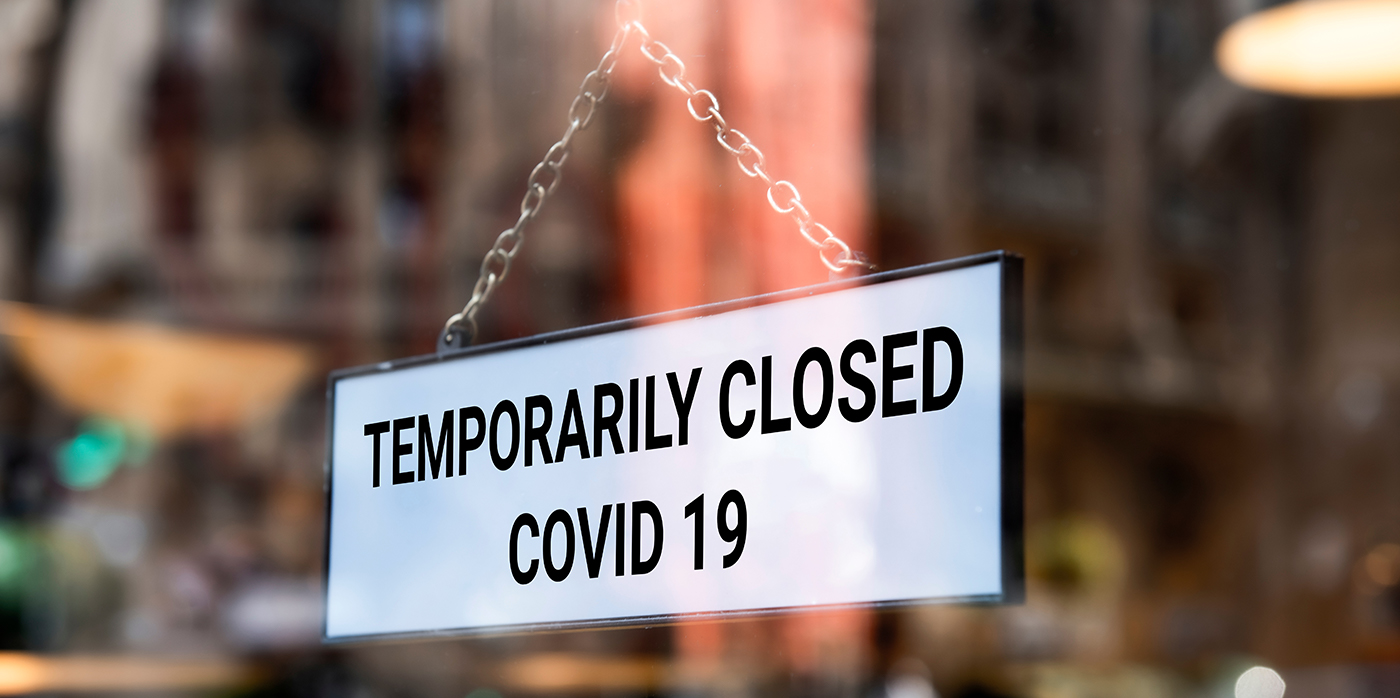 closure sign in shop window due to Covid 19
